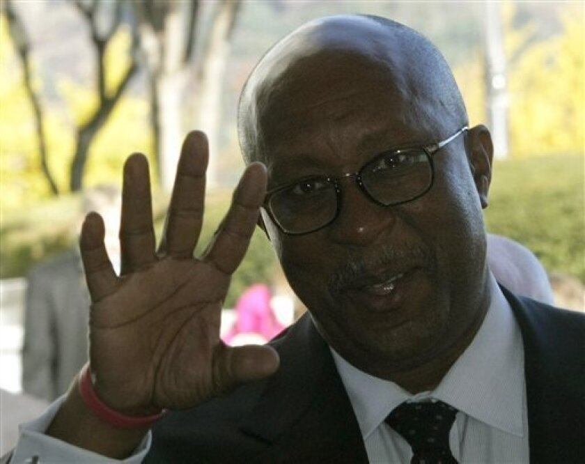 U.S. Trade Representative Ron Kirk gestures as he arrives to meet his South Korean counterpart Kim Jong-hoon at the Foreign Ministry in Seoul, South Korea, Tuesday, Nov. 9, 2010. (AP Photo/Ahn Young-joon)