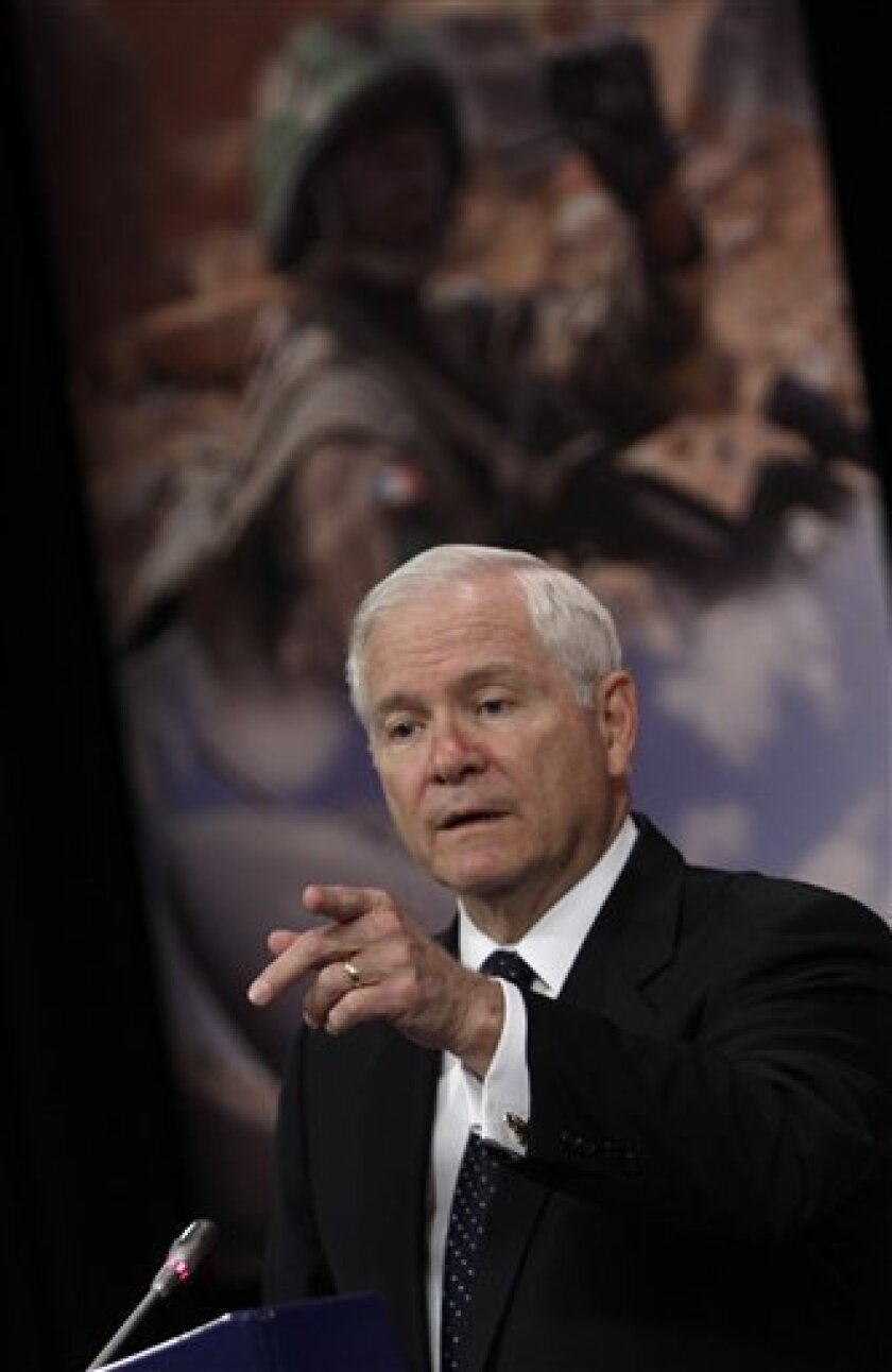 U.S. Defense Secretary Robert Gates gestures while speaking during a media conference after a meeting of NATO defense ministers at NATO headquarters in Brussels on Thursday, June 9, 2011. NATO defense ministers shift their focus from Libya to Afghanistan during talks on Thursday. (AP Photo/Virginia Mayo)
