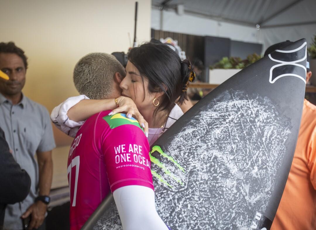 Filipe Toledo is hugged by his wife, Ananda Marcal, before his match Gabriel Medina