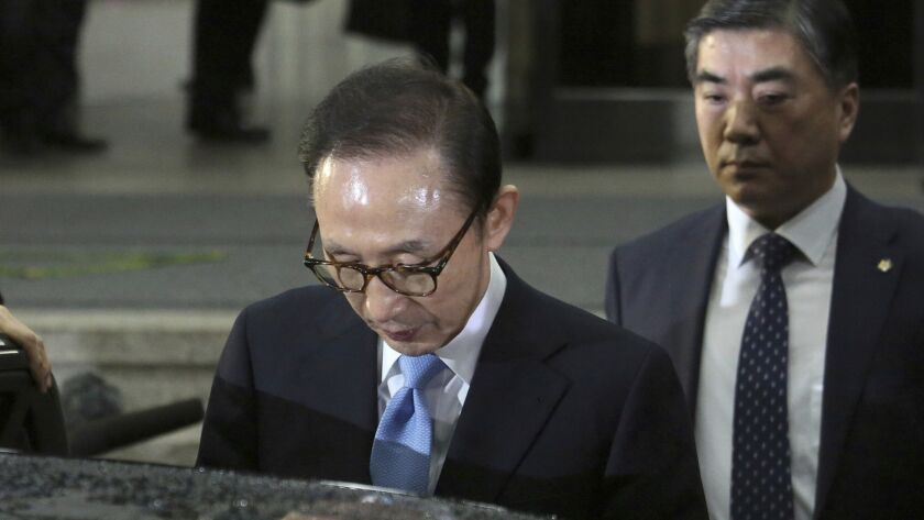 Former South Korean President Lee Myung-bak, leaves the Seoul Central District Prosecutors Office after being questioned by investigators on March 15.