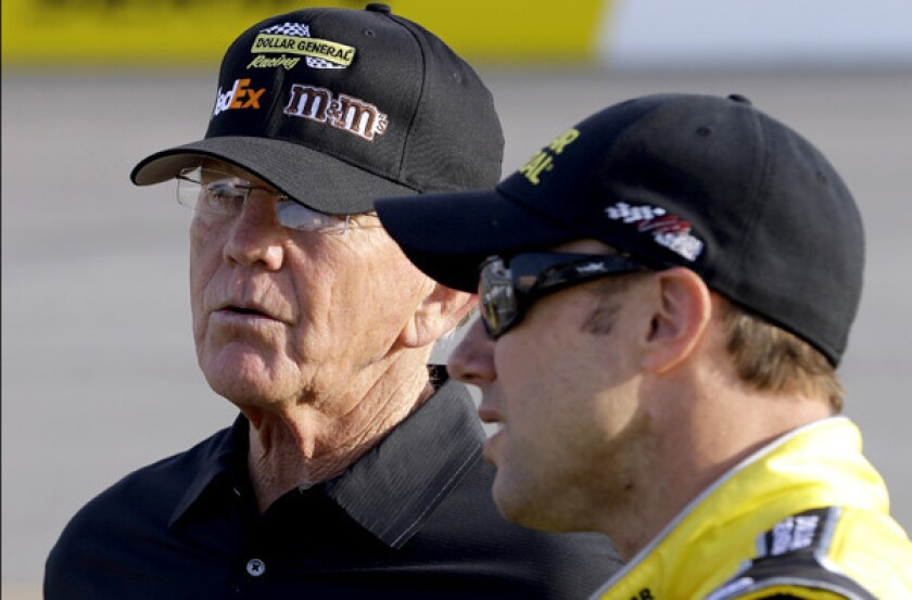 NASCAR team owner Joe Gibbs, left, talks with driver Matt Kenseth during qualifying for the Sprint Cup Series race at Richmond International Raceway last month.