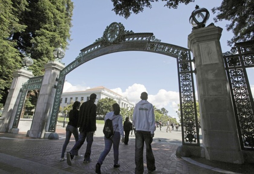 A group of students walk through the Sather Gate at UC Berkeley.