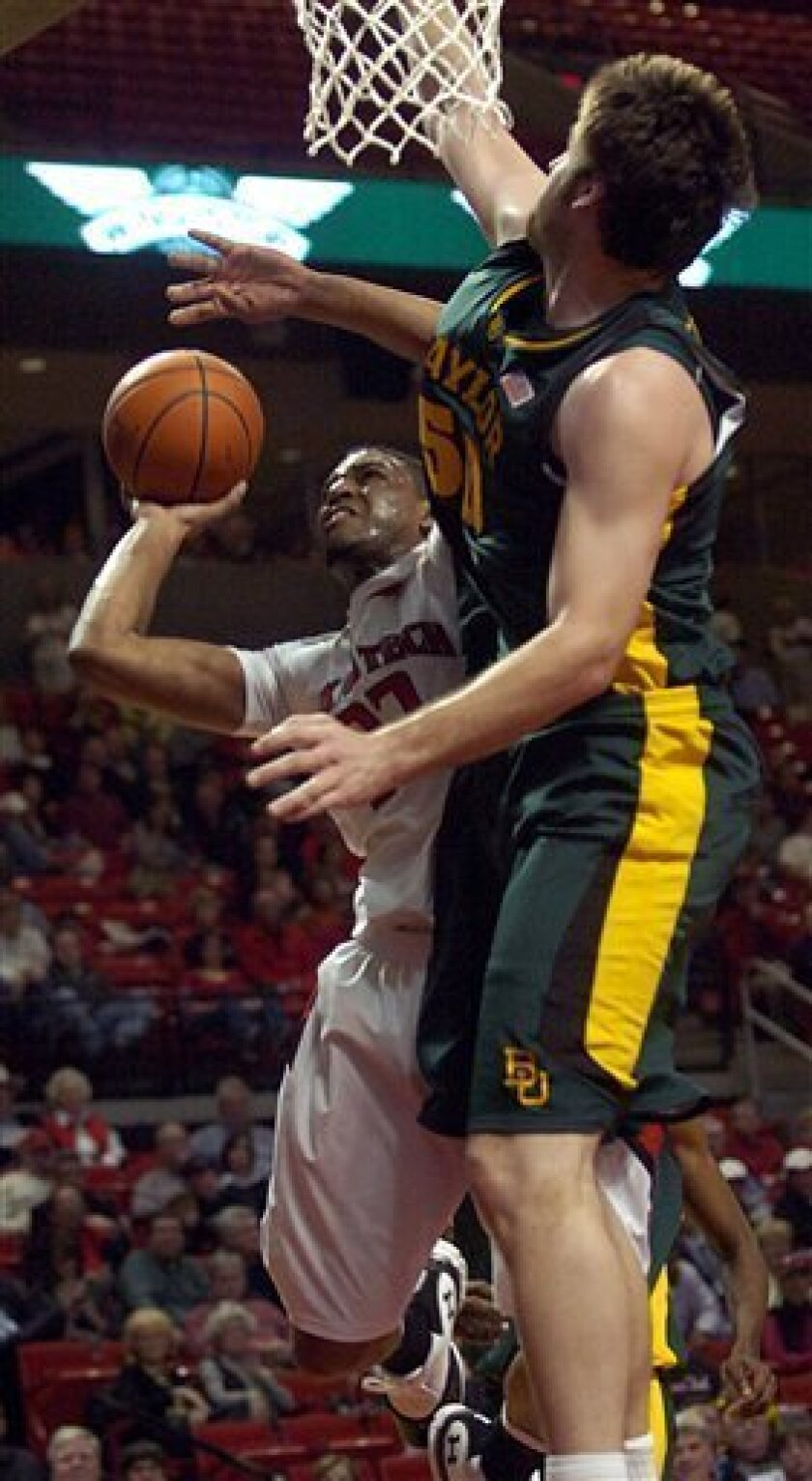 Baylor's Josh Lomers, right, rejects a shot from Texas Tech's Mike Singletary during the first half of an NCAA college basketball game Tuesday, March 2, 2010, in Lubbock, Texas. (AP Photo/Geoffrey McAllister)
