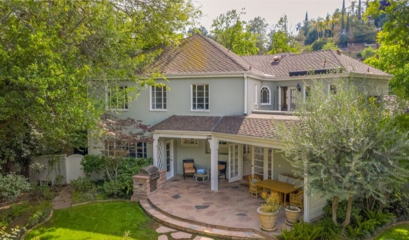The corner-lot property has a 1930s home, saltwater swimming pool and custom cedar sauna.
