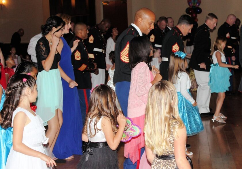 Marines and their daughters at the 8th annual Father- Daughter Dance hosted by the Armed Services YMCA Camp Pendleton.
