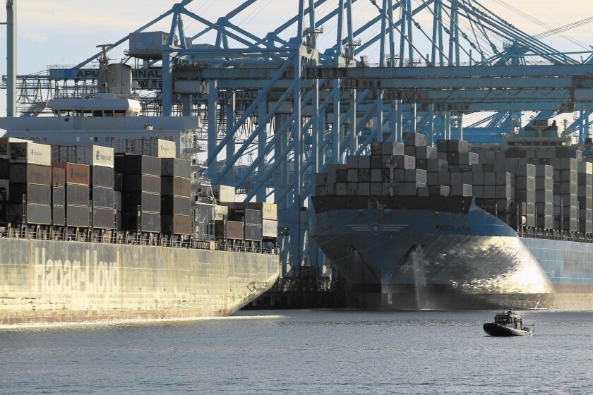 A container ship is docked at the Port of Los Angeles on Terminal Island.