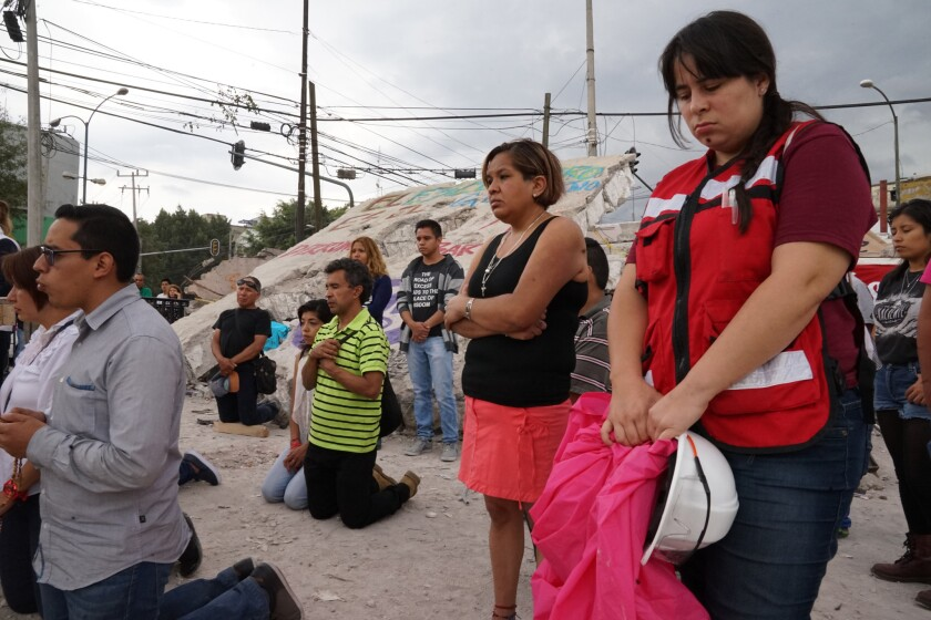 Lina Kuhn Santillan, right, an architect and volunteer with the rescuers at the factory, returned Se