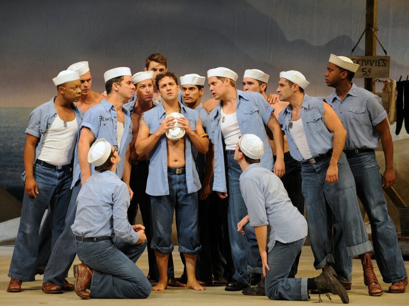 "Jason W. Webb, center, as Seabee Luther Billis, with the company of Moonlight Stage Productions' ""South Pacific"" at the Moonlight Amphitheatre in Vista."