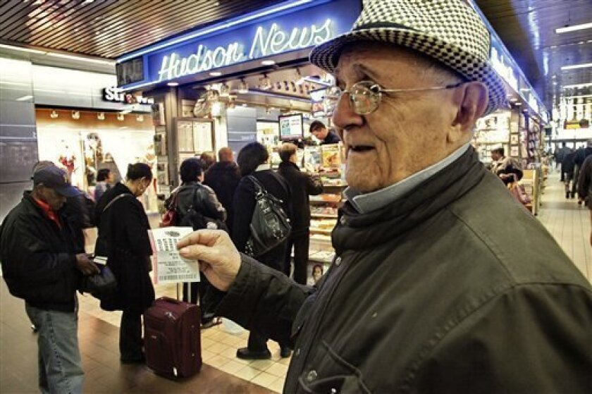 Alfredo Mora, 91, shows off his lottery ticket for a chance at the historic Mega Millions jackpot, that reached more than $600 million on Friday, March 30, 2012, in New York.  After nobody won the March 27 drawing, the jackpot rolled over creating the largest pool of lottery money ever recorded in