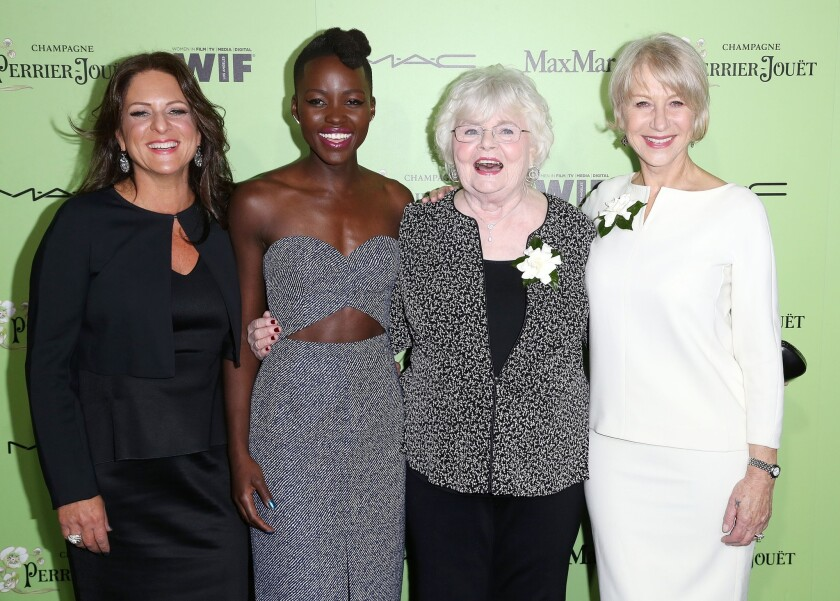 Producer Cathy Schulman, left, and actresses Lupita Nyong'o, June Squibb and Helen Mirren attend the Women in Film pre-Oscar cocktail party.