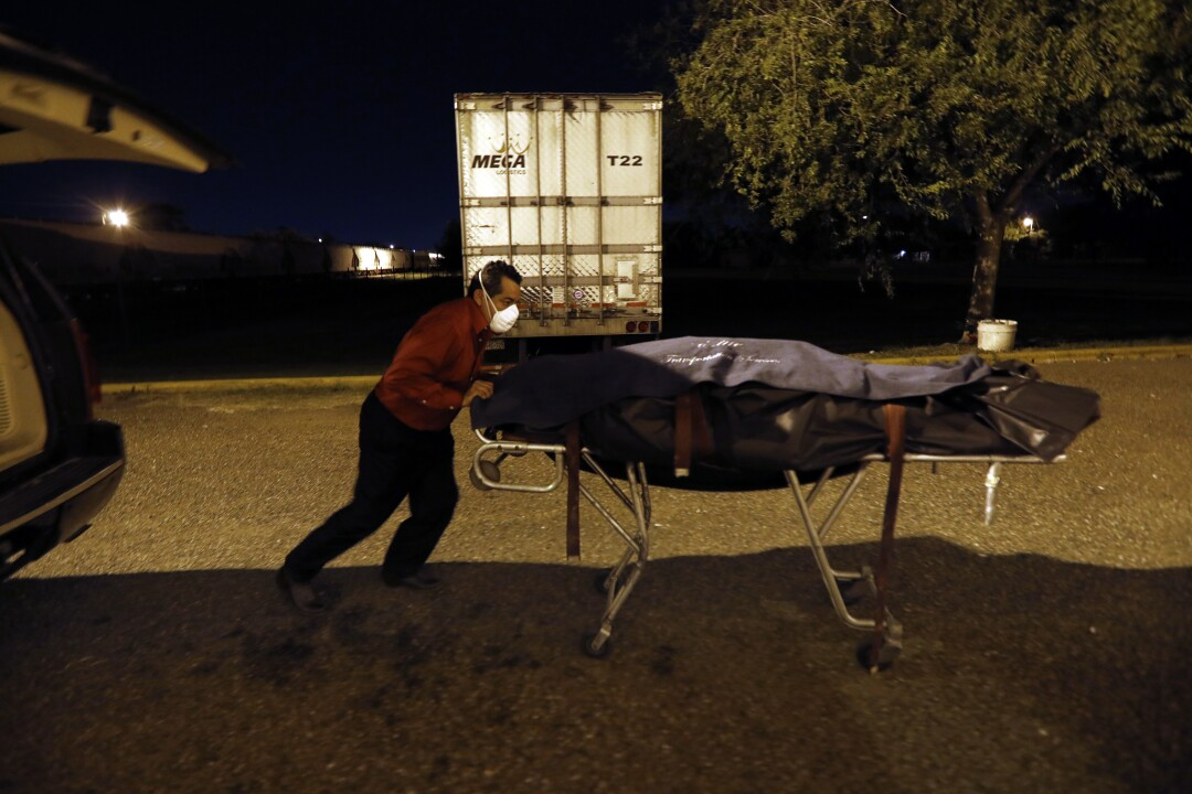 Juan Lopez went from moving 15 bodies a week before the pandemic to 22 some days in Texas' Rio Grande Valley.