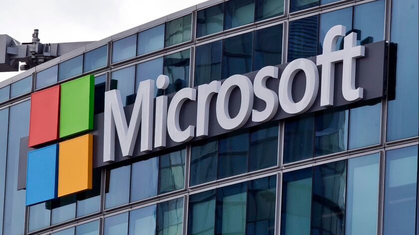FILE - This April 12, 2016, file photo shows the Microsoft logo in Issy-les-Moulineaux, outside Pari