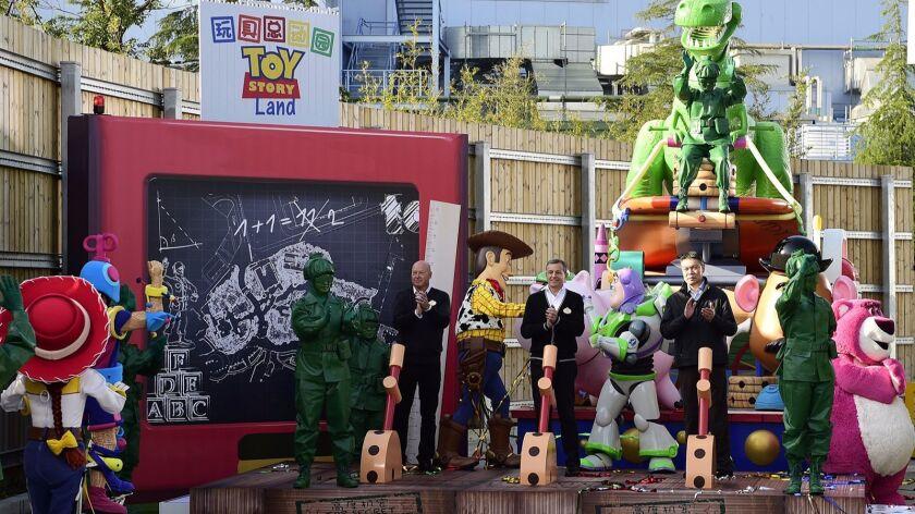 Bob Chapek, chairman of Walt Disney Parks and Resorts, from left; Walt Disney Chief Executive Bob Iger; and Fan Xiping, chairman of Shanghai Shendi Group break ground on Toy Story Land at Shanghai Disneyland.