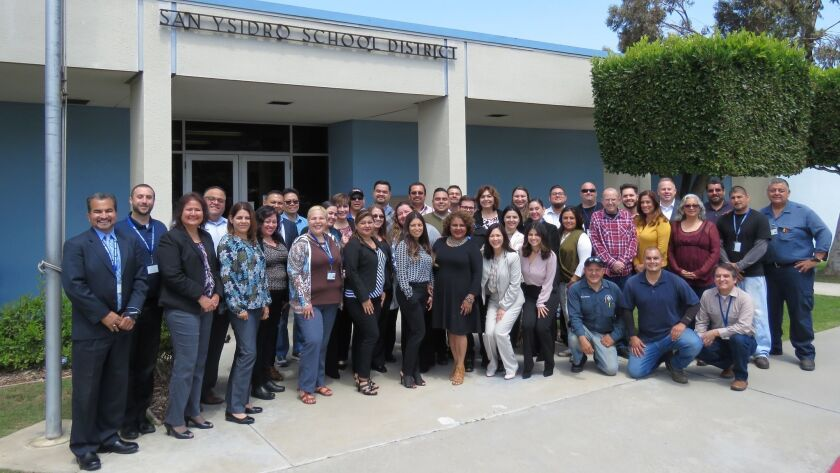 San Ysidro School District Superintendent Gina Potter with other district employees on her first day on the job.