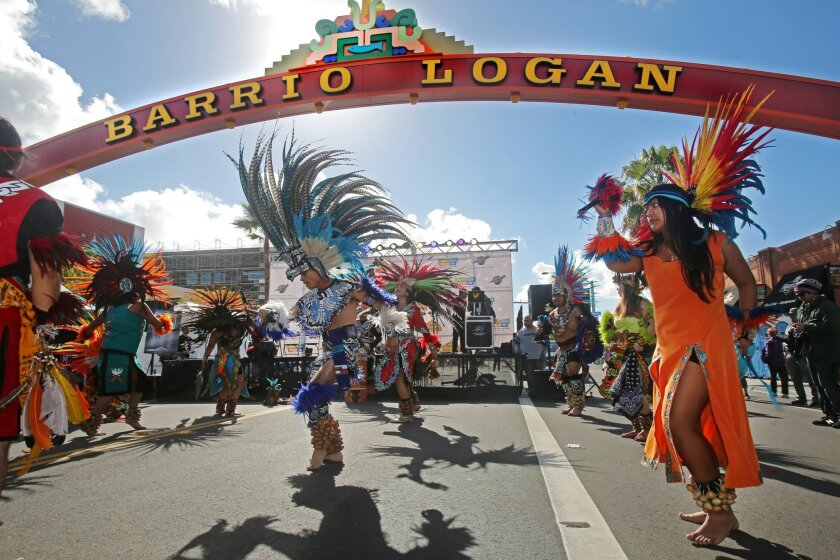 Aztec dancers perform during Saturday's celebration of the new gateway sign for Barrio Logan