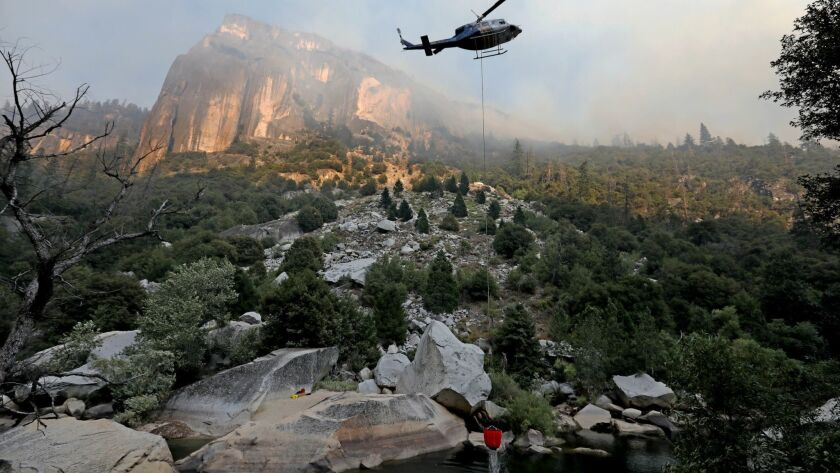 Helicopter crews work to stamp out the Ferguson fire as it burns along El Portal Road, a key entryway into Yosemite Valley.