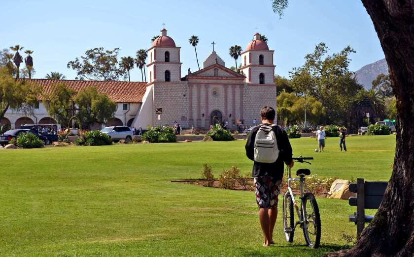 The Old Mission Santa Barbara sits next to a big lawn at the foot of a spectacular hillside neighborhood.