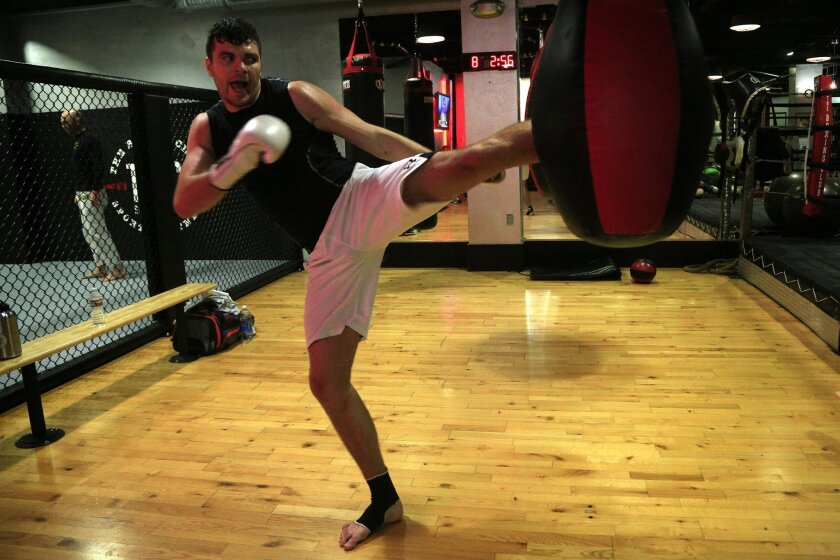 Russian fighter Artem Levin trains on a heavy bag at The Boxing Club near UTC mall in La Jolla. Artem is ranked number one in the world in Muay Thai.
