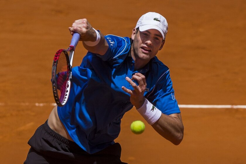 John Isner from US returns the ball during his Madrid Open tennis tournament match against Adrian Mannarino from France in Madrid, Spain, Monday, May 4, 2015. (AP Photo/Andres Kudacki)