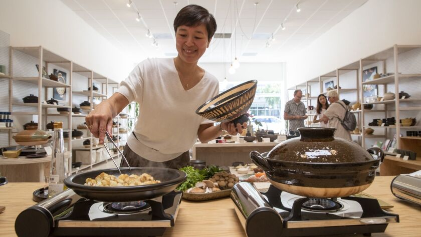 Naoko Takei Moore, owner of Toiro, cooks lunch for her staff. Moore gave private donabe cooking lessons before opening the store in 2017.