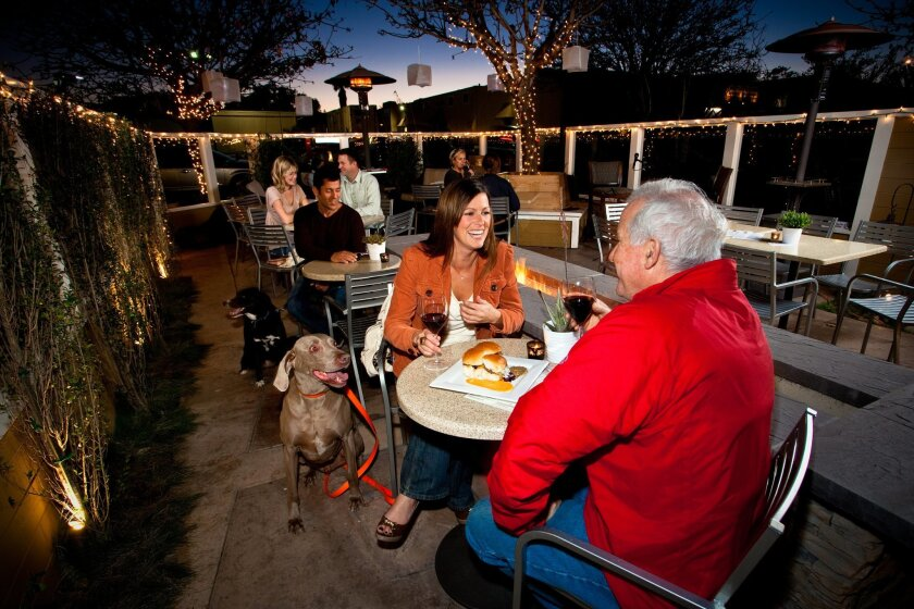 "The Wine Pub on Shelter Island/Point Loma is one of many San Diego restaurants that not only allows dogs but encourages owners to bring their pooches. The Wine Pub is so dog-friendly, in fact, it offers a ""homemade K-9 menu."" A new state law that went into effect Jan. 1 makes it legal for all resta"