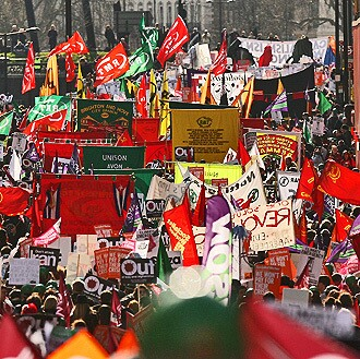 """Demonstrators take part in the """"Put People First"""" march through central London."""