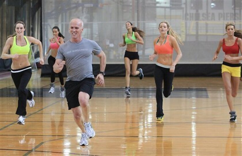 This photo taken Nov. 11, 2009 shows celebrity trainer David Kirsch, third from left, running with Allison Turner, far left, Alicia Hall, second from left,  Tika Ivezaj, third from right, Jamie Lee Darley, second from right, and  Kylie Bisutti, far right, during a workout session in the Angel Boot
