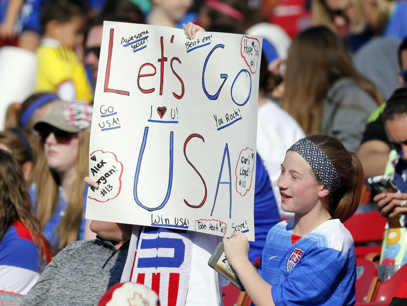 Fans cheer on the United States in the second half of a CONCACAF Olympic qualifying tournament soccer match against Mexico Saturday, Feb. 13, 2016, in Frisco, Texas. The U.S. won 1-0. (AP Photo/Tony Gutierrez)