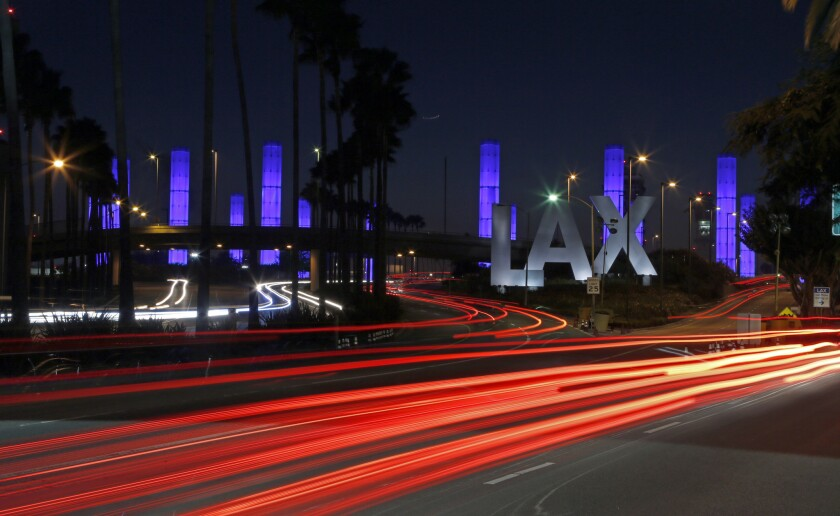 A food catering company at Los Angeles International Airport has sued the city to fight an order that the company pay higher wages to 271 workers.