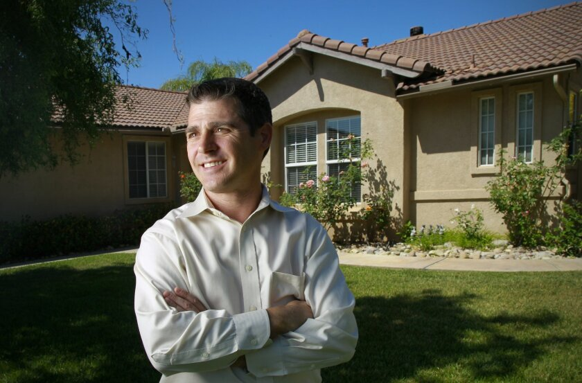 Homeowner Chad Sanfilippo at the home he purchased in 2013. He lost a previous home to a Short Sale in 2009.