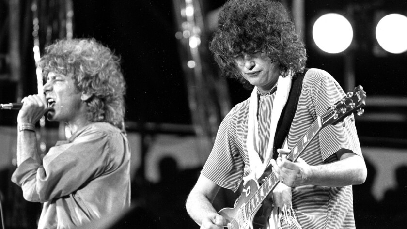 Singer Robert Plant, left, and guitarist Jimmy Page of the British rock band Led Zeppelin perform at the Live Aid concert at Philadelphia's J.F.K. Stadium on July 13, 1985.