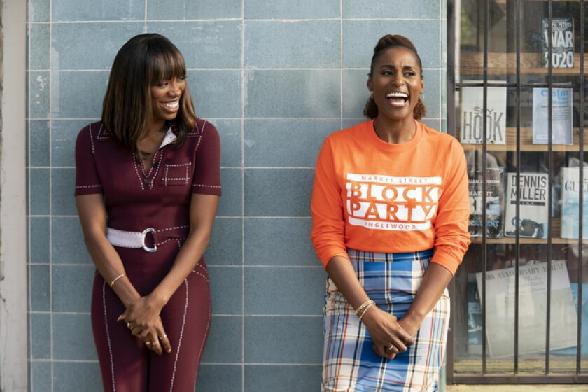 """Insecure"" stars Yvonne Orji, left, and Issa Rae out and about in the city we love."