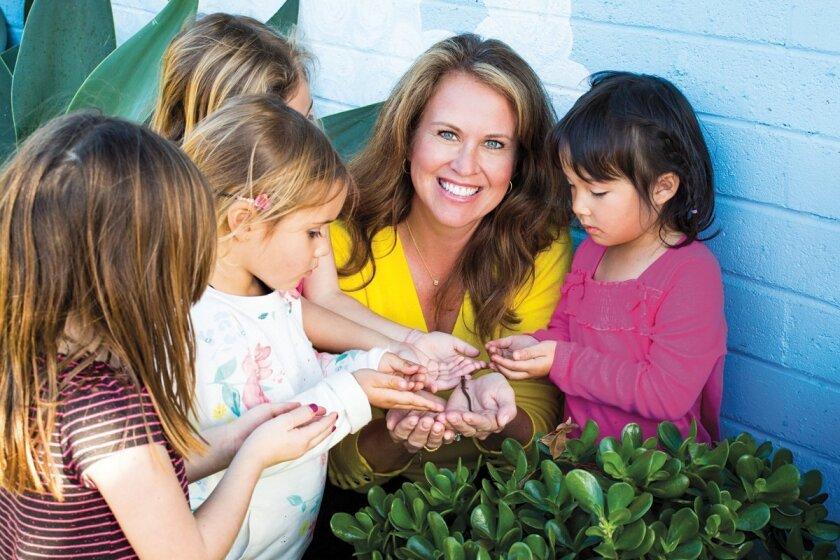 La Jolla United Methodist Church Nursery School director Bridget Musante with nursery school students enjoying the day in the community garden.