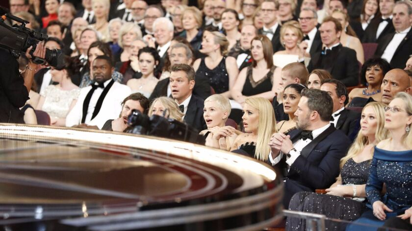 """Stars express shock as they hear that """"La La Land"""" was incorrectly named best picture."""