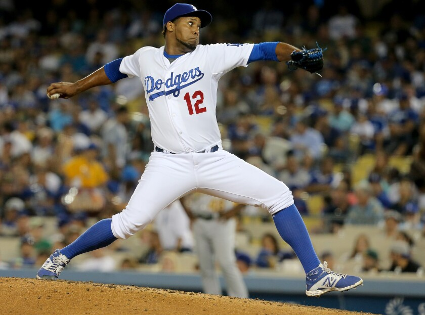 Dodgers' Juan Nicasio pitches against Oakland on July 29.