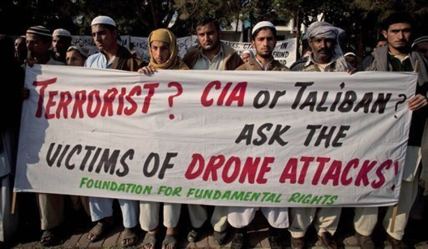 In this Friday, Dec. 10, 2010 file photo, Pakistani tribal villagers hold a rally to condemn U. S. drone attacks on their villages in border areas along the Afghanistan border, in Islamabad, Pakistan. The head of a U.N. team investigating casualties from U.S. drone strikes in Pakistan declared  on