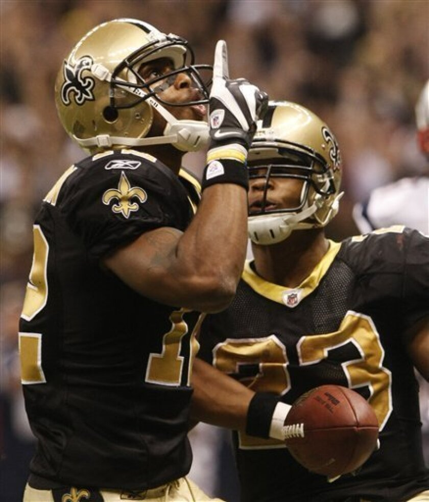 New Orleans Saints Marques Colston, left, celebrates his 20-yard touchdown pass with Pierre Thomas during the fourth quarter of an NFL football game against the New England Patriots, Monday, Nov. 30, 2009, in New Orleans. (AP Photo/Dave Martin)