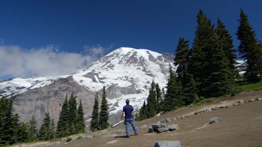 "Brock Mullins in front of Mount Rainier in the feature film ""Return to Seattle."" Credit: Light with"