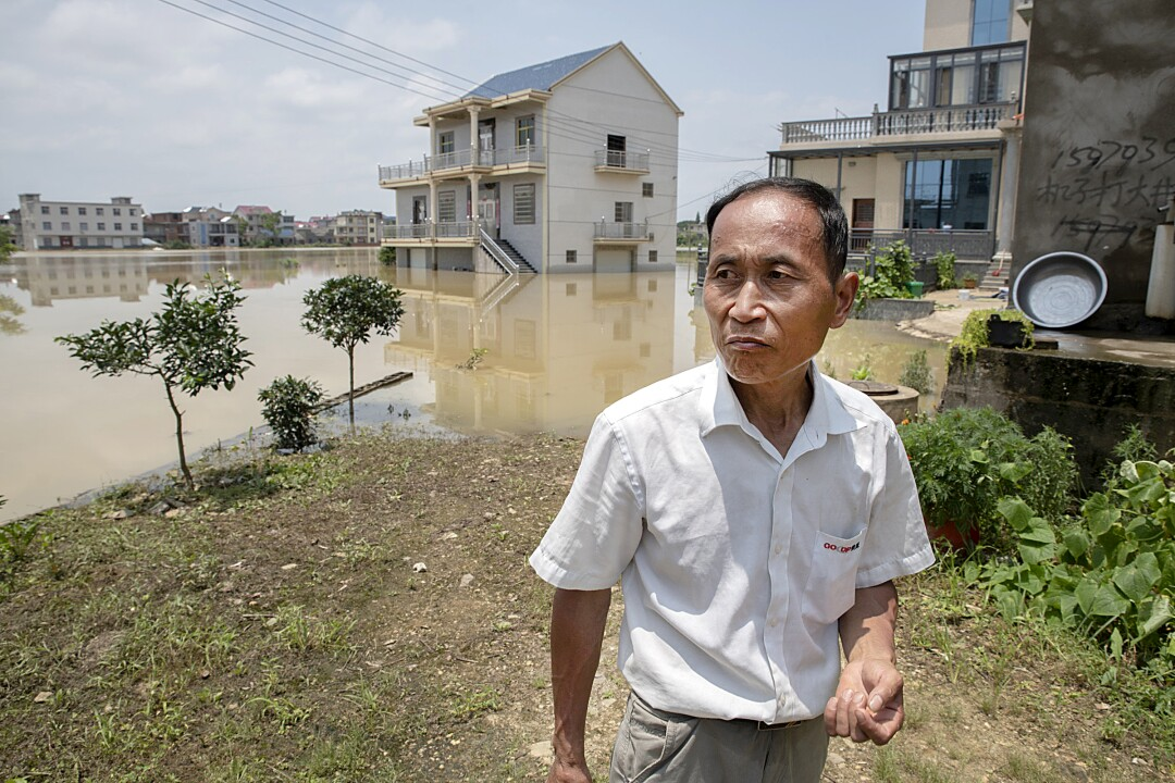 Cheng Xuannan, a resident of Chengjia village, where people have been stranded for a week without help.