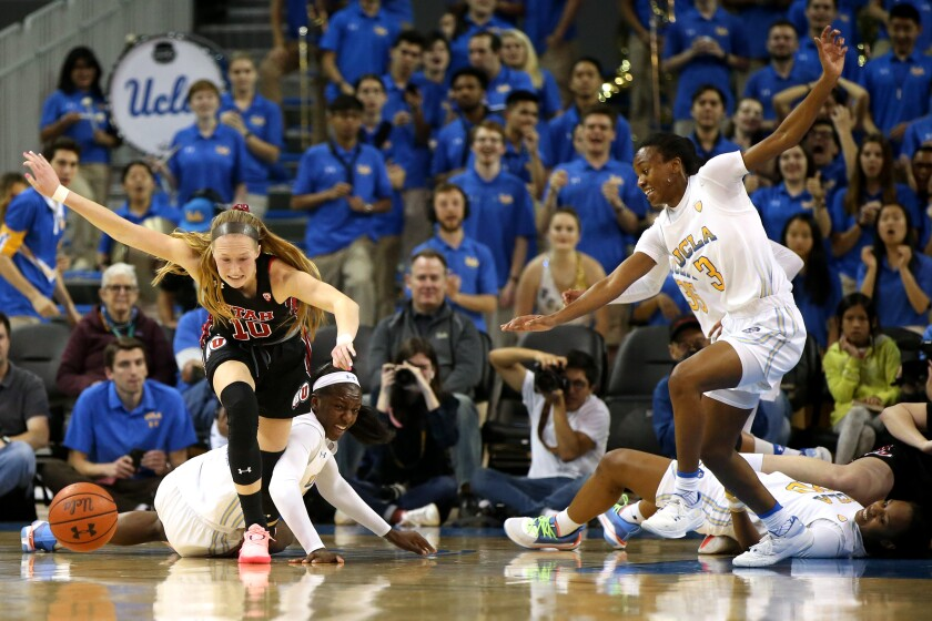 Utah's Dru Gylten (10) and UCLA's Kiara Jefferson (3) fight for control of the ball during the second quarter at Pauley Pavilion on March 1.