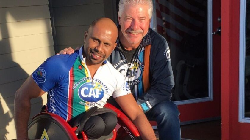 In Kennewick, WA last Saturday, cyclist Bill Geppert visited with Hassan, an amputee born in Somalia