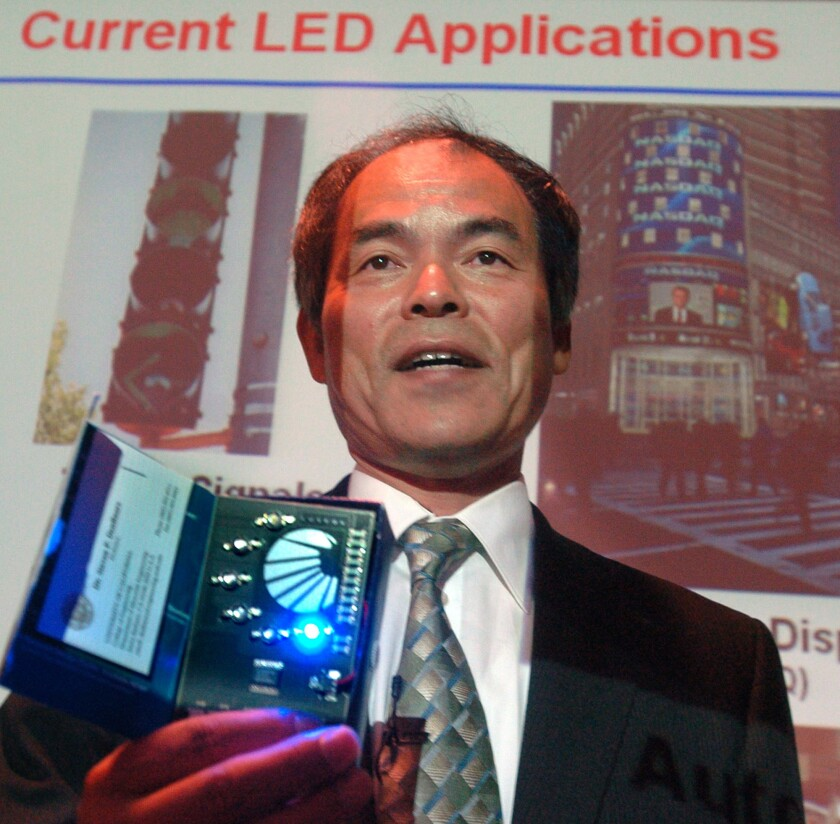 Shuji Nakamura demonstrates different LED lights during a presentation in Santa Barbara in 2006.