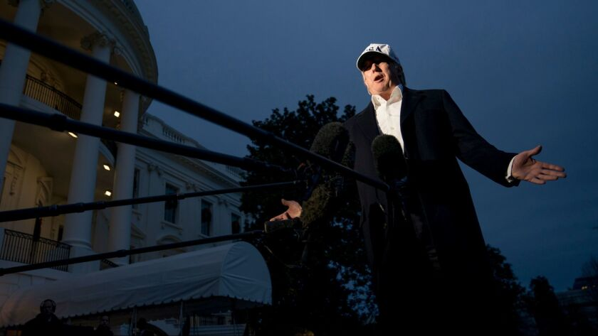President Donald Trump speaks to members of the media on the South Lawn at the White House in Washington on Dec. 17.