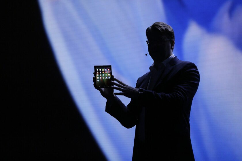 Justin Denison, SVP of Mobile Product Development, shows off the Infinity Flex Display of a folding smartphone in San Francisco on Nov. 7.