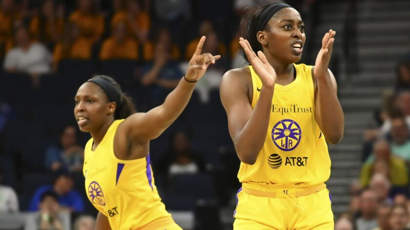 Los Angeles Sparks guard Chelsea Gray, left, and forward Chiney Ogwumike, right, celebrate after a t