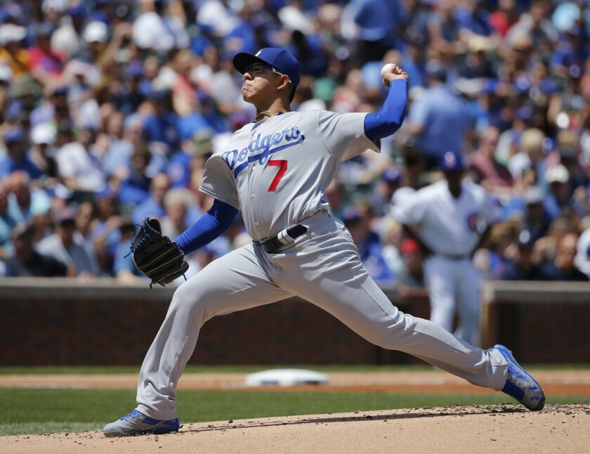 Los Angeles Dodgers starting pitcher Julio Urias delivers during the first inning of a baseball game against the Chicago Cubs Thursday, June 2, 2016, in Chicago. (AP Photo/Charles Rex Arbogast)