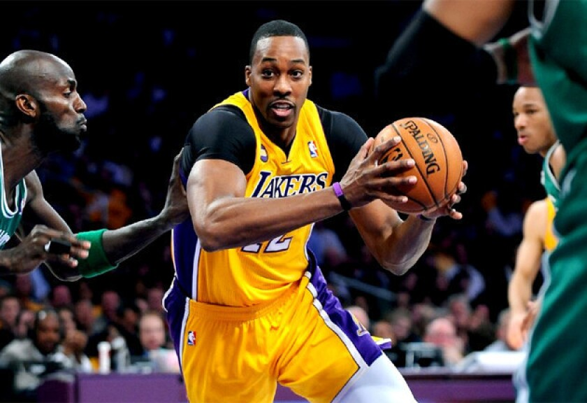 Lakers center Dwight Howard drives to the basket on Celtics' Kevin Garnett.