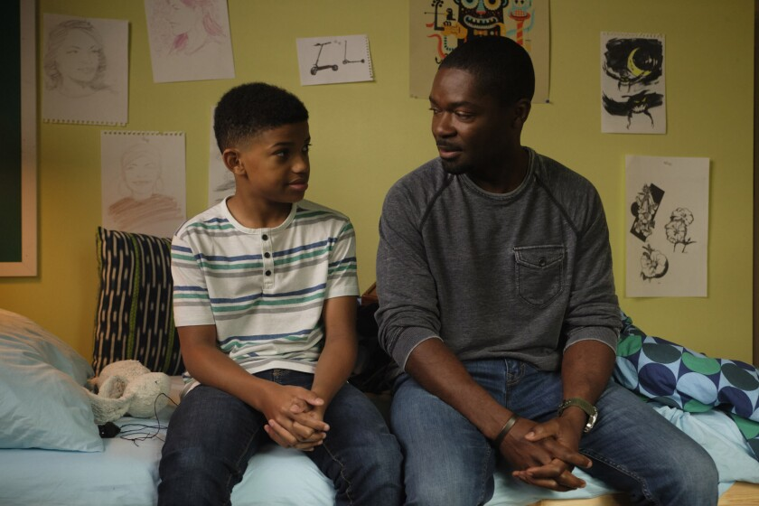 """Lonnie Chavis, left, and David Oyeylowo sit on a bed in """"The Water Man."""""""
