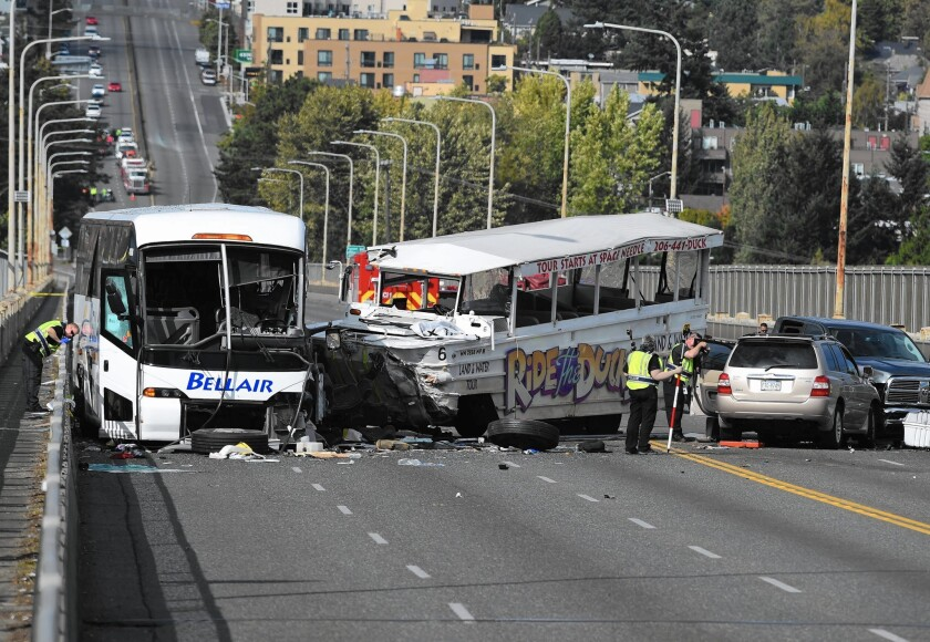Duck boat collides with bus in Seattle