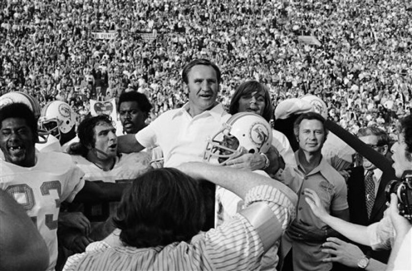 FILE - In this Jan. 14, 1973 file photo, Miami Dolphins coach Don Shula is carried off the field after his team won the Super Bowl game with a 14-7 victory over Washington, in Los Angeles. The Dolphins team that achieved the only perfect season in NFL history will be honored by the White House next Tuesday, Aug. 20, 2013, more than 40 years after its accomplishment. (AP Photo/File)